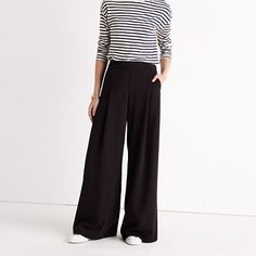 """With drapey wide legs and subtle front pleats, these pants have a bit of a '40s-film-icon feel while being pull-on easy. Swingy, special, totally fuss-free. <ul><li>Sit above hip.</li><li>Slouchy fit through hip and thigh, with a wide leg.</li><li>Front rise: 12 5/8"""".</li><li>Inseam: 31 1/2"""".</li><li>Leg opening for size 0: 34 1/2"""".</li><li>65% poly/31% visc..."""
