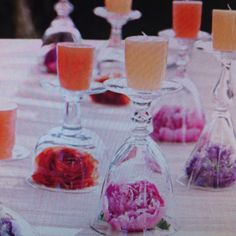 wine glass upside down with a flower blossom inside and a candle on top makes great table decor.