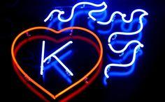 neon K in a blazing heart
