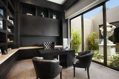 Lovely Chic Office Decor Image Gallery in Home Office Contemporary design ideas with Lovely armchairs backyard built-in cabinets built-in shelves chocolate brown computer desk courtyard Dark