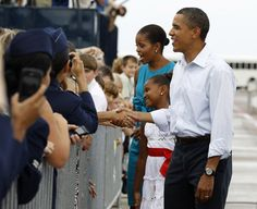 "apsies: "" The President, First Lady, and their daughter Sasha Obama greet servicemen and their families as they arrive at Tyndall Air Force Base in Florida, August 14, 2010. (via) """