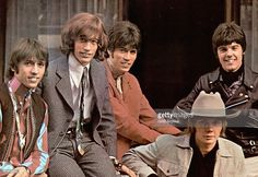 Photo of Barry GIBB and Robin GIBB and Maurice GIBB and BEE GEES; L-R: Maurice Gibb, Robin Gibb, Barry Gibb, Colin Petersen (seated front), Vince Melouney