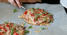 Pizza med bunn av nøtter, egg og ost