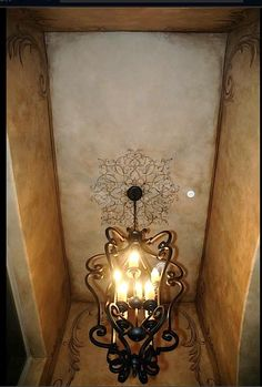 Aged look ceiling with Modello stencil medallion in center