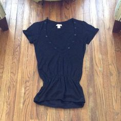 Lux black low cut button top Size small. 10 buttons line the top, 5 on each side. 100% cotton. Very stretchy and has an eyelet-like print throughout. Cinched waist. Looks great with black jeans. In great condition. Feel free to ask me any questions😊 Urban Outfitters Tops