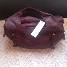 Purple handbag. LOTS OF POCKETS IN THIS BAG. New with tag.  Has many pockets. Bags Satchels