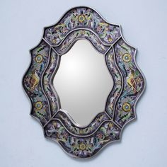 A hand-painted decorative wall mirror can add so much style to your home or office. This ornate mirror, by Asunta Pelaez, features reverse painted glass and plywood. The purple background beautifully showcases delicate flowers and songbirds.