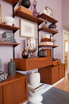 """""""Shelving system:  I bought it from Pepe's on Sunset (he makes them). But they are basically repro's of mid-century modular systems that can be really expensive.  This system was $600.  I'm sure someone could make a badass version with ready-made cabinets. """""""