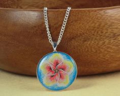 Red and Yellow Flower on a Blue Background Resin by Careish, £8.50