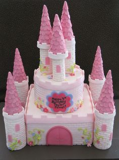 This pink castle cake was for a 3 year old little girl. Thanks to the many great CC cakes for inspiration!
