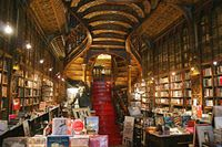 """Bookshelves in Livraria Lello, a bookstore near Praça dos Leões in Porto, Portugal.  From the website:  """"Opened in 1906, Livraria Lello is one of the most beautiful bookstores in Porto and the world. It is the flagship store for one of the most important Portuguese publishing houses. Co-owner Antero Braga is usually around, knows the Portuguese book market in and out, and will be glad to help you find exactly what you want even when you don't have a clue about what that may be."""""""