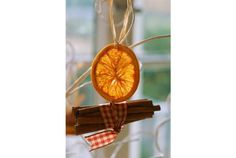 dry orange slices in oven or microwave. works with lemons and limes, also. Add ribbon and cinnamon sticks for an ornament that smells wonderful.