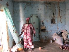 Ami Diarra from Mali stands in her home.