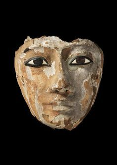 Wooden face with inlaid eyes, originally part of a coffin, 25th Dynasty, Neo New Kingdom, (825 - 670 BCE). Possibly from excavations at Abydos. Courtesy Two Temple Place and Baghshaw Museum (Kirklees Council).