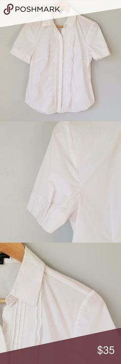 """Ann Taylor White Short Sleeve Button Down Ann Taylor White Short Sleeve Button Down//Nice detailing down the front covering the buttons//Button closures on each sleeve//Bust: 18"""", Length: 24"""", Sleeve length: 8.5""""//Materials: 72% cotton, 23% nylon, 5% spandex//Size: US Women's 4 Ann Taylor Tops Button Down Shirts"""