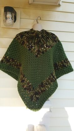Hot Off My Hook! Project: Cowl-Neck Poncho Started: 07 Aug 2015  Completed: 10 Aug 2015 Model: Madge the Mannequin Crochet Hook(s): 7mm, Cowl, J, Granny Stitch Yarn: Redheart Super Saver  Color(s): Camouflage, Medium Thyme Pattern Source: Simply Crochet Magazine Issue No. 25 Pattern Designed By: Simone Francis Notes: This is my 16th Cowl-Neck Poncho!