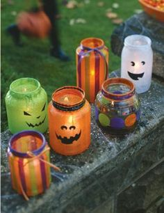 Decoupaged Halloween lanterns from recycled glass jars.