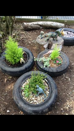 Outdoor small world area. Tyres filled with mud and topped with gravels, stones, bark, slate etc to provide natural sensory experiences.