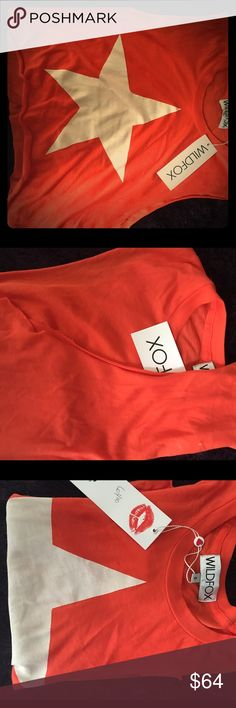 WildFox seamless tank w white star In orange w white star, this seamless tank is the most have this year! Goes great for anything! Cut offs, reg shorts, skinnies u can match w blazer and jeans... Very cool unisex price is firm I can make listings on Ⓜ️ercari for a cheaper price but posh takes off 20% and I have a store to run.. All sales are final Thanks SALE!! MORE U BUY MKRE DISCOUNT 3 =30% and so on... Of any mix any style any brand Wildfox Tops Tank Tops