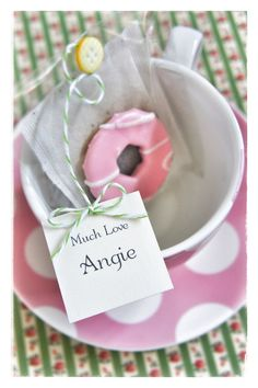 A fabulous, cute tea and biscuit favour combined with a place name - who can resist the lure of a party ring...yum! Priced from £2.15 each