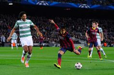 Neymar of FC Barcelona shoots towards goal under a challenge by Virgil van Dijk of Celtic FC during the UEFA Champions League Group H match between FC Barcelona and Celtic FC at Camp Nou on December 11, 2013 in Barcelona, Catalonia.