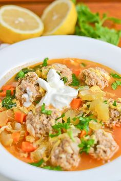 This Romanian meatball soup uses lemon and tomato to give the broth a tangy sour taste. The meatballs are cooked in the broth and consists of rice and bread Sicilian Recipes, Greek Recipes, Soup Recipes, Dinner Recipes, Cooking Recipes, Healthy Recipes, Romanian Recipes, Eastern European Recipes, Romania