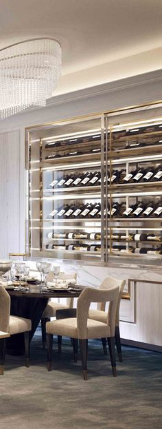 I would love a built-in wine wall to display my favorite wine bottles in the dining room. Dining Room Design, Modern Dining Room, Dining Room Decor, Interior Design, Wine Closet, Home, Wine Wall, Interior, Luxury Dining Room