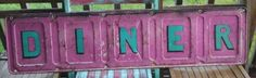 Diy Diner sign on peice of an old PINK tailgate from a truck. Not sue what kind. So cute. Fun! Painted, chippy,  vintage. Funky junk by tina