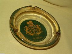 ALDOS ASHTRAY EAGLES NEST WASHINGTON DC GREEN GOLD LION SHIELD YELLOW GLASS