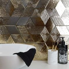 Alive with texture, these Gold Ore Hexagon Tiles tiles have a tribal pattern etched into their surface. Use them to add the Midas touch onto your wall spaces. Gold Bathroom, Bathroom Interior, Bathroom Ideas, Spanish Interior, Hexagon Tiles, Gold Texture, Modern Interior Design, Wall Tiles, Diy Home Decor