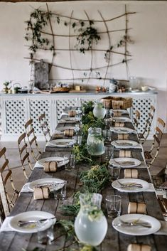 Localmilk | Rustic dining arrangement, tablescape greens, classic white plates + wooden table + chairs