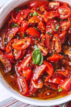 Marinated Cherry Tomato Salad - Really, reeeeeeally delicious! A super simple tomato salad with a punch of flavor.