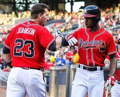 Aug 9, 2013; Atlanta, GA, USA; Atlanta Braves third baseman Chris Johnson (23) celebrates a three run home run with center fielder B.J. Upton (2) in the first inning against the Miami Marlins at Turner Field. Mandatory Credit: Daniel Shirey-USA TODAY Sports