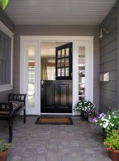 love dutch front doors - black door/gray siding/white trim.  I want to do this into my laundry room.