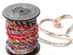 Handmade fabric twine on old wooden spool