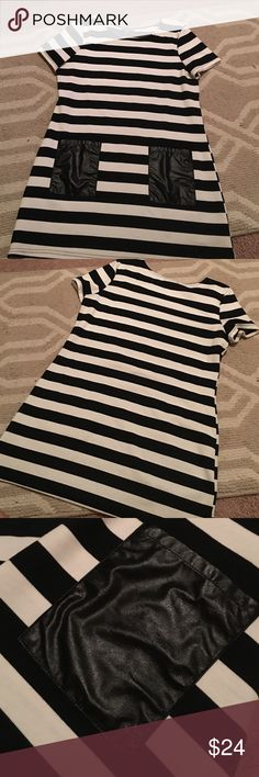 Black & white stripe dress Perfect B&W dress! Two front faux leather pockets! Runs smaller about a junior medium size Dresses Mini