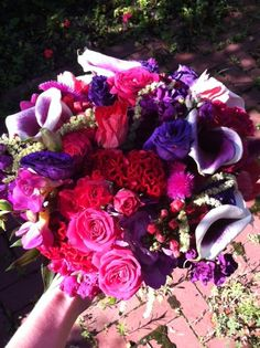 Bridal bouquet featuring pinks and purples created by Lexington Floral in Shoreview, MN.    #flowers #bride #wedding