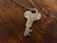 We stamp old keys and make them new! (Isaiah 43:19) Order your custom word! Silver and gold, modern or vintage, various necklace chain lengths! Head over to our jewelry shop!