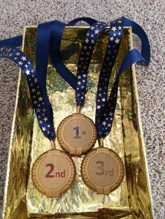 Pinewood Derby awards for Cub Scouts. The medal is Hubba Bubba gum container painted gold. It is attached to the ribbon with gold duct tape.