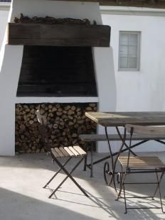 Plain and simple, but still beautiful. The storage area below makes for easy fire refueling. Outdoor Oven, External Doors, Bbq Area, Bistro Chairs, Light My Fire, Amazing Spaces, House Entrance, Outdoor Entertaining, Hearth