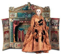 c1880 French Doll with Toy Theater - from auction records. Theater was made using various Pinot  Saguire, Epinal images.