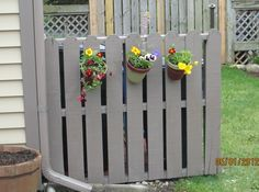 A shipping pallet can also act as a handy screen for trash bins.