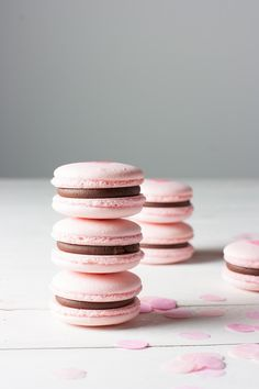 Traditional French macaron recipe using Italian meringue method. Pink Valentine macarons, chocolate ganache filling + airbrushed hearts for Valentine's Day!