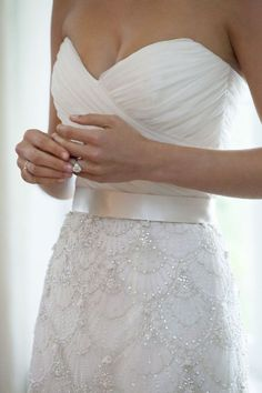 I really like the sweetheart neckline and the ribbon around the waist.  Understated elegance!