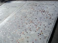 """Tourists toss pennies onto Benjamin Franklin's grave for good luck. Famous for saying """"A penny saved is a penny earned"""", I doubt Ben would approve of such wastefulness!"""