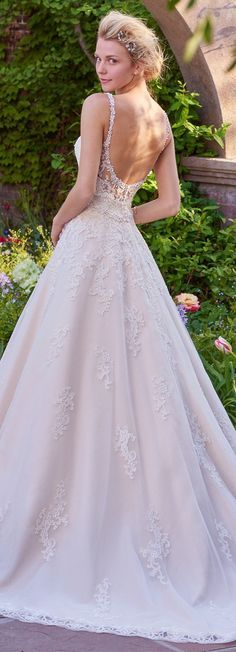 Rebecca Ingram Wedding Dress 2017 | This gorgeous ballgown features a layer of lace appliqués over tulle. A V-neckline and open back with lace illusion trim add hints of alluring romance. Accented with Swarovski crystal belt and embellished straps | @maggiesottero #rebeccaingram #rebeccabride