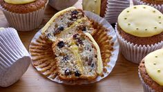 Dan Lepard pays homage to the Easter simnel cake: a layer of golden marzipan runs through the centre of each cupcake, while the cream cheese helps to keep these mini-fruitcakes moist.