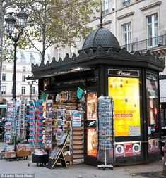 More than Parisians have signed a petition to save the iconic green domed newspaper kiosks in the French capital, which are set to receive a modernist makeover (pictured). Kiosk Design, Signage Design, Store Design, Design Design, Environmental Graphic Design, Environmental Graphics, Vintage Newspaper, Japanese Graphic Design, Exhibition Display