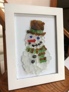 In the meadow we can build a snowman . sea glass snowman made with sea glass found along the Lake Erie shore. Rare orange nose sea glass piece White Frame Cardstock white or ivory Few black stones for mouth and buttons Sea Glass Crafts, Sea Crafts, Sea Glass Art, Seashell Crafts, Sea Glass Jewelry, Stained Glass, Christmas Pebble Art, Christmas Art, Xmas