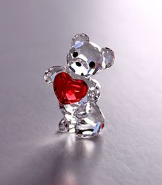 Swarovski, Capture and express affection with this adorable and sweet faceted clear crystal Kris Bear. Holding out a Light Siam crystal heart full of love, he looks innocent with gleaming eyes and nose in Jet crystal.